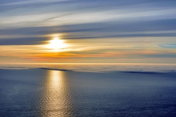 Great 'sunset' of the Midnight Sun, from Nordkapp, Norway, with half of the water covered with sea fog.