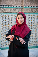 Arab woman in traditional clothing with hijab on her head