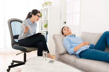 depression woman lying down on sofa relaxing