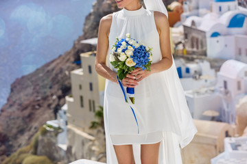 Beautiful woman in white dress with wedding bouquet