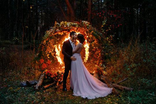 Night wedding ceremony. Outdoor.