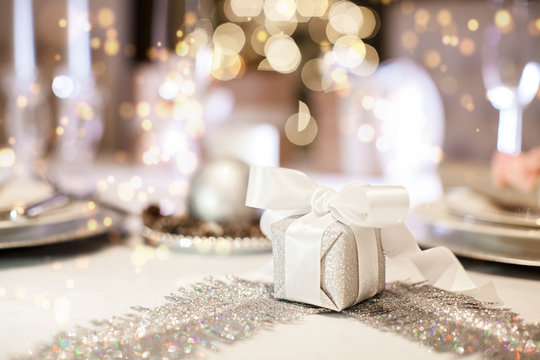 Beautiful gift box on the table. Christmas background. (soft focus)