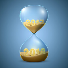 Hourglass. New Year's concept of transition from 2017 to 2018.