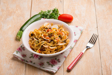 tagliatelle with clams zucchinis and tomatoes sauce