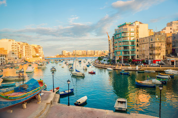 beautiful view of harbor with maltese yachts and boats in St. Julians to Sliema, Spinola Bay, Malta