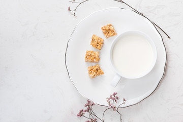 Breakfast with milk. Glass of milk on table.