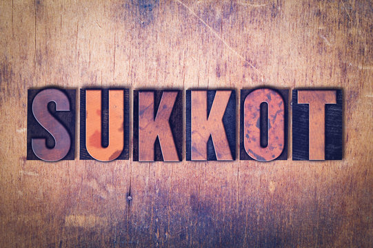 Sukkot Theme Letterpress Word on Wood Background