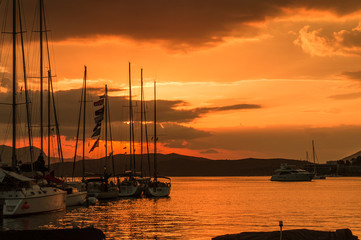 Sailing boats at sunset in Poros island in Greece