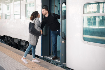 Love couple hugging before leaving on train