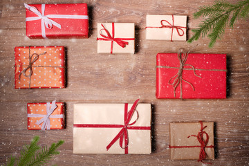 Christmas presents in decorative boxes, whit wood background