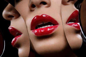 beautiful woman lips closeup with mirror reflections