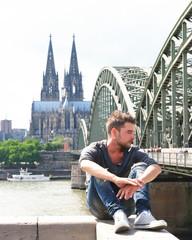 Man relaxing riverside Cologne
