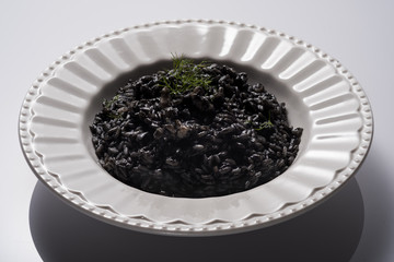 Cuttlefish ink and bogue risotto