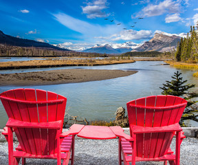 Two red comfortable loungers by the lake