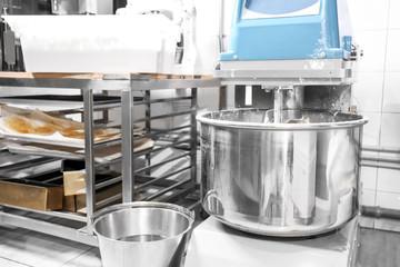 Modern dough mixer in bakery