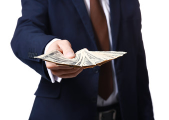 Man in formal suit holding money on white background, closeup