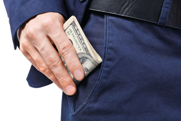 Man in formal suit putting money in pocket on white background, closeup
