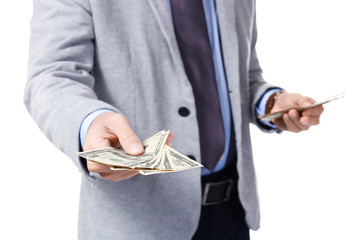 Man in formal suit holding money on white background