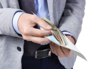 Man in formal suit counting money in envelope on white background, closeup