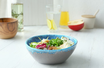 Bowl with delicious vegetable salad on table