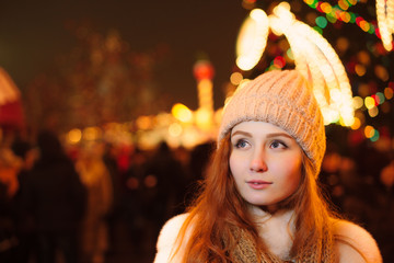 red-haired girl in christmas, outdoor