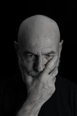 Serious Old Men Portrait on Black Background