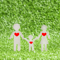 abstract model family with red hearts. family love concept, on green grass background. Valentine's Day