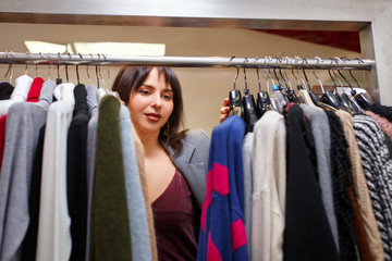 woman chooses clothes in the store