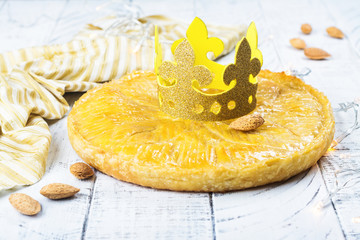Homemade Galette des Rois cake with handmade kings crown. Traditional French Epiphany cake with ground almond