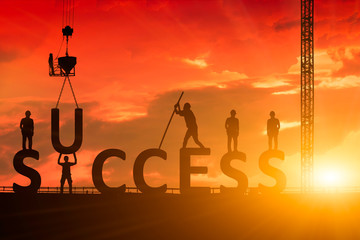 Silhouette of the success of the construction worker, the concept of success of the work is tired than to accomplish it, which has been difficult.