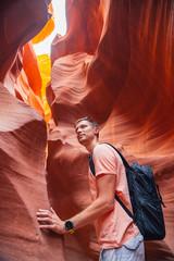 Young man exploring antelope Canyon in the Navajo Reservation near Page, Arizona USA