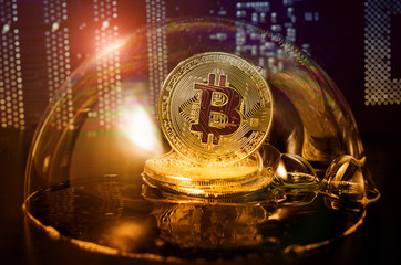 Bitcoin. Bitcoin in a soap bubble on video card background.