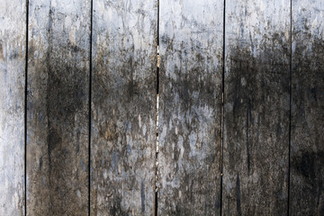 Rough grungy grey wooden floor photo background. Rustic wood plank closeup.