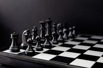 Black chess figures on board. Black chess set in order for game start.