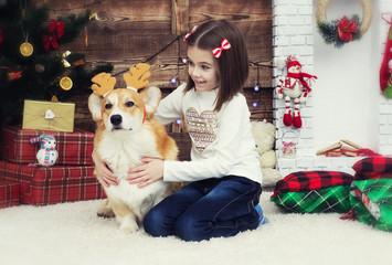 girl gently hugs a dog