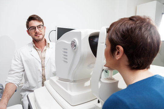 eye Doctor is measuring a patient's visual field with the OCT test /Ophthalmologist in eyes clinic is doing diagnostic vision exam/ concept health and eyes care