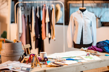 Fashion designer working place with tailoring tools and drawings on the table Wall mural
