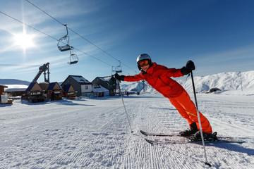 Foto op Aluminium Ontspanning Woman prepares to ski in Gudauri ski resort, Georgia