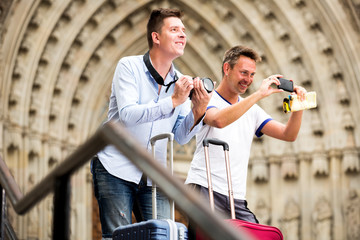 Male travellers with digital camera