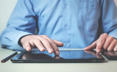 Man using black digital tablet.