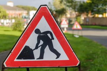 Roadworks Ahead men at work warning sign