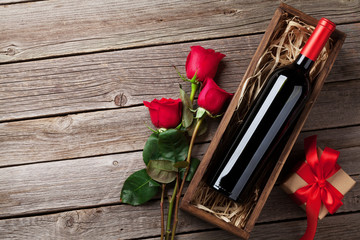 Red rose flowers, wine and gift