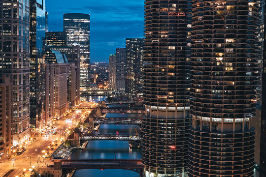 Chicago, Illinois. Cityscape at night with marina city tower, river, empty road and bridge in sight. Taken from London House Chicago. July, 2017.