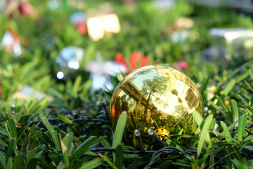 Christmas decoration golden ball  on abstract bokeh background. Merry christmas & Happy New Year greeting card. Christmas ball golden with copy space