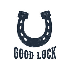 """Hand drawn horseshoe textured vector illustration and """"Good luck"""" inspirational lettering."""