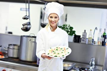 Busy chef at work in the restaurant kitchen