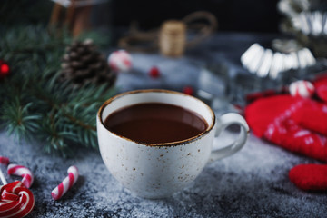 Tuinposter Cup of hot chocolate or cocoa and variety of christmas sweet candies