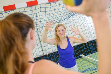 female athlete ready to shoot a handball goal