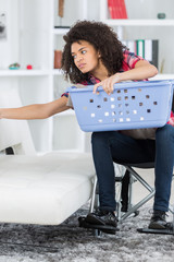woman in wheelchair doing laundry