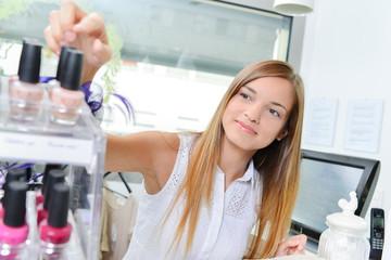 Woman selecting a bottle of nail polish